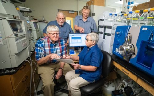 Picture of four scientists in a lab