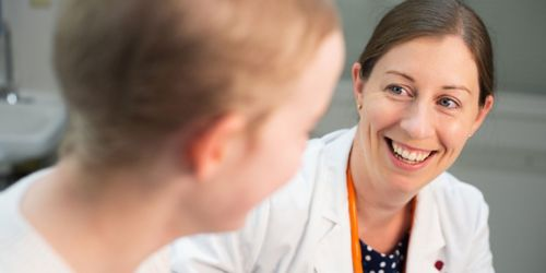 Image of Aimee Talleur talking to patient