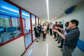 Participants touring the new equipment in Structural Biology.