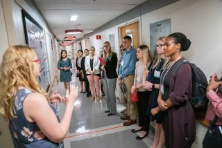 Participants touring the Center for Advanced Genome Engineering facility.