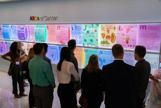 Taking a break at the ABC wall to see cancer from a patient's perspective.