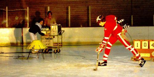 Man with hockey stick in lab gear