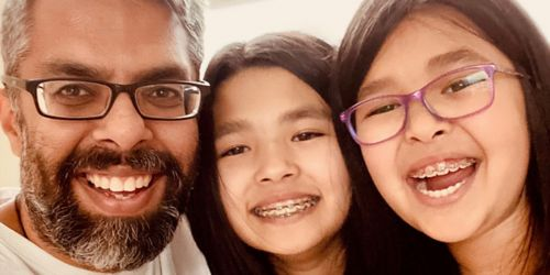 From left, Niraj Trivedi, of St. Jude Developmental Neurobiology, with his daughters Kiran, 11, and Simi, 8.