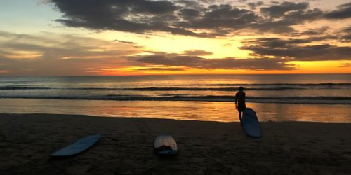 image of surfer at sunset