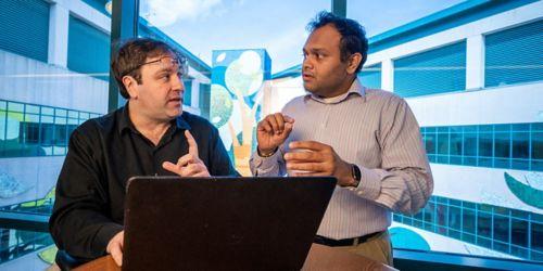 Image of 2 men at laptop