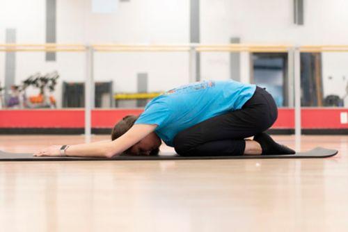 yoga instructor doing child pose