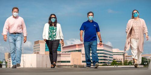Four people walking outside