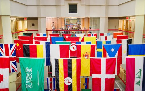 International flags hanging in the Danny Thomas Research Tower atrium.