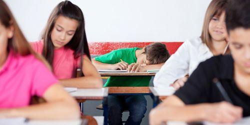 Image of boy sleeping in class