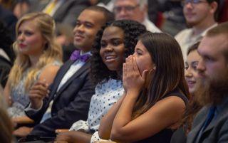 Audience reacting to speaker.