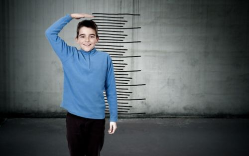 Boy with growth chart