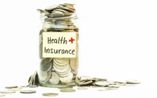 """Jar with money labeled """"Health  insurance"""""""