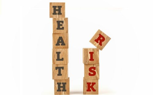 Image of building blocks that spell Health Risks