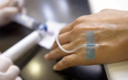 Patient with IV in hand