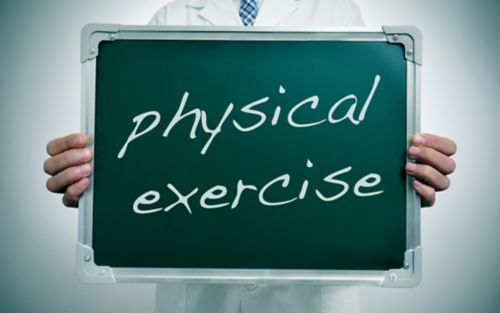 """Doctor holding sign that says """"physical exercise"""""""