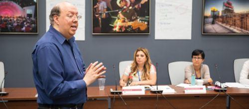 Man teaching in Masters Program classroom