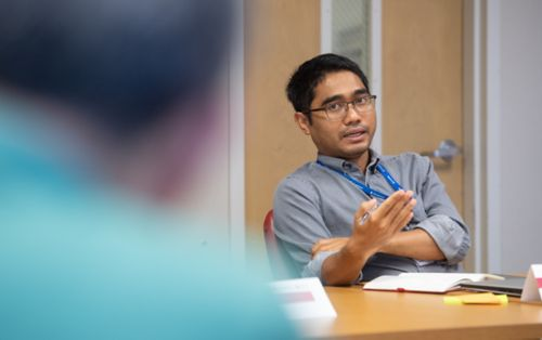 Male graduate student in classroom