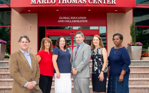 Photo of group of people standing outside Marlo Thomas Center