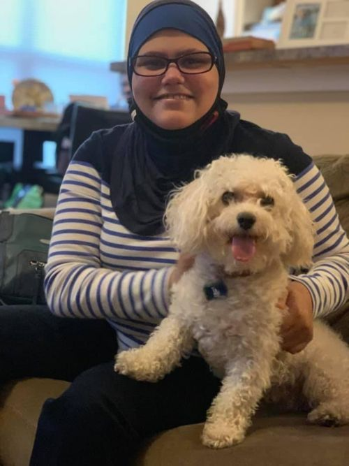 Nora in November 2020 with her sister's dog, Angel. Her sister Deena was inspired to go to medical school because of Nora's experience as a cancer patient.