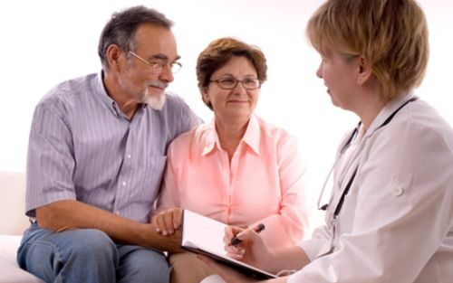 Image of doctor talking to couple