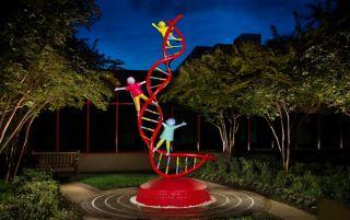 sculpture of dna strand with children