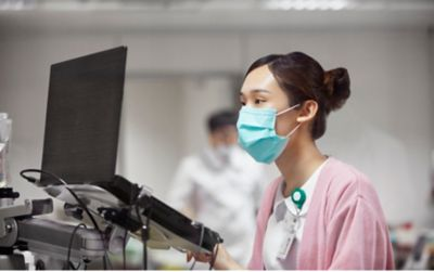 Nurse working at computer
