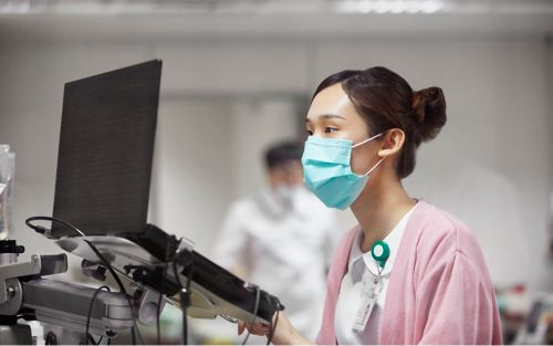 Nurse working at computer