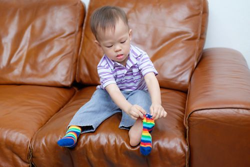 Sitting down while dressing or undressing can help if children tire quickly or have balance concerns.