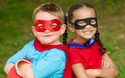 Two children dressed up as superheroes