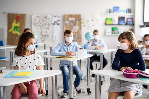Masks are still recommended in schools for anyone who isn't vaccinated. At least 3 feet of distance inside the classroom is also recommended.
