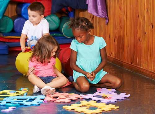 children playing in a playroom together