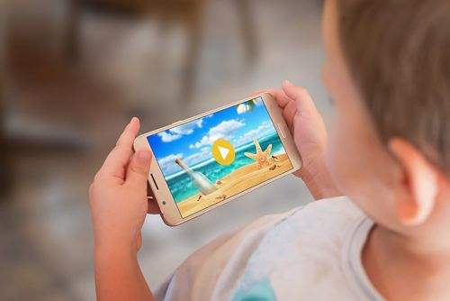 A child watching a video on a mobile phone