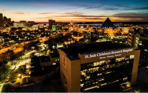 St. Jude hospital with Memphis skyline, at night