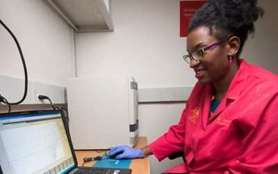 Jasmine Turner analyzes data from samples to determine the presence of influenza. She credits her mother for encouragement and inspiration to pursue a scientific career.