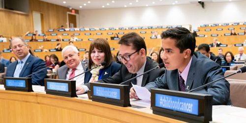 Young man speaking at UN, sitting next to four other people