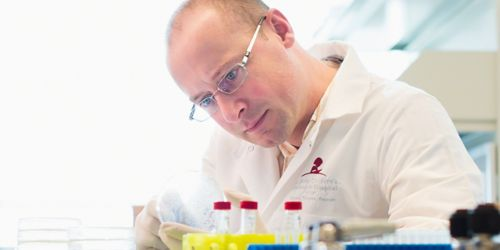 Photo of Ben Youngblood, PhD, in his lab